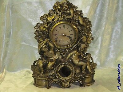 c. 1865 AMERICAN CLOCK Co. CUPID and GRAPES IRON FRONT SHELF CLOCK by Muller