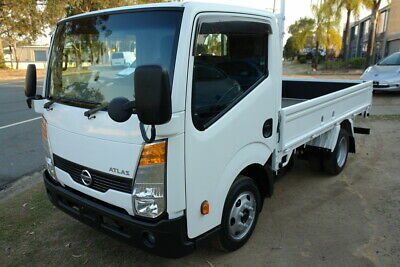 2012 F24 NISSAN ATLAS DX 1.3 TONNE TRAY TRUCK. LOW 168,000km. READY FOR WORK .