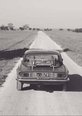 Triumph spitfire, on gravelly road in Puglia, south Italy, red car