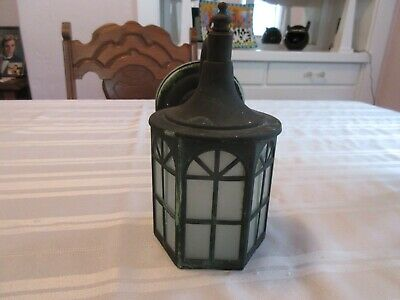 Antique Outdoor Electric Light Fixture With A Copper Finish