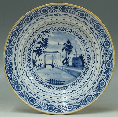 a rare antique 18th c Dutch tinglazed delft plate with canal scene