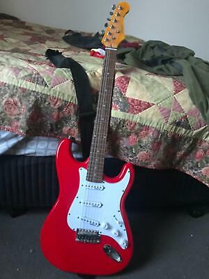 Red 'Artist' electric guitar, carry bag strings, tuner, amp, 2 cables, 12 picks