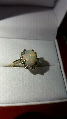 White gold 620 mark, antique fire opal with 6 diamonds, one owner,beautiful