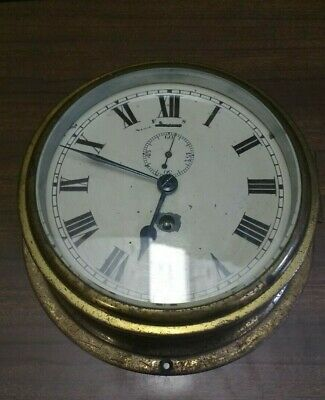Antique brass port hole clock.