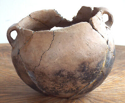 loop handled Mississippian pottery bowl , artifacts arrowheads