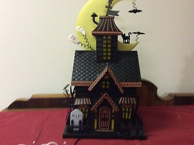 Metal Haunted House With Light With Tags