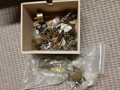 assorted mechanical clock parts