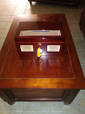 Versailles humidor holds 100 cigars. . finish is perfect