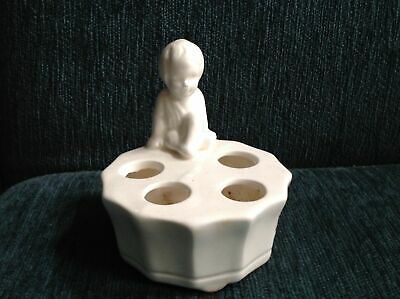 Vintage ceramic toothbrush or lipstick holder young child in thought.