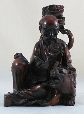 chinese carved wood depicting a oriental man reading;  Height-23cm;