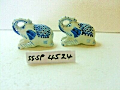 blue and off white elephants salt or pepper shakers