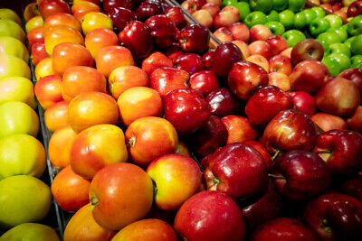 Apples on display, colorful orange red green grocery store produce (READ)