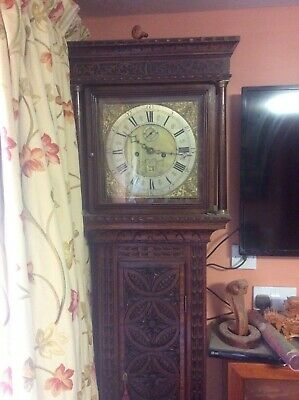 Carved longcase grandfather clock