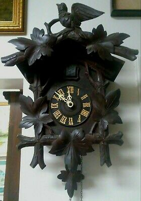 Vintage: Black Forest German Cuckoo Clock 8 Day Movement- Carved Style.