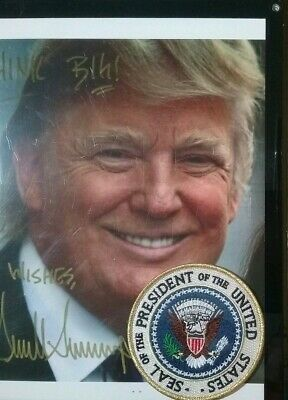 8x10 Autographed Photo Of President Trumph With The Presidential Seal.
