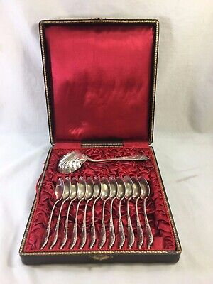 Fine antique Roussel French sterling silver dessert spoon set in box