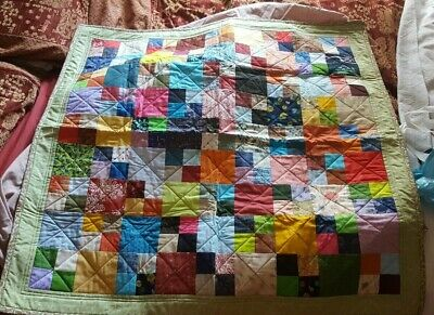 Handmade lap/cot quilt . multicoloured patchwork. 100cm x 100cm. NEW