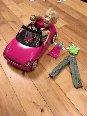 barbie convertible car, two barbie dolls and outfits, bundle