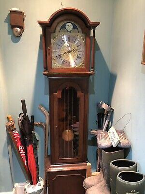 Dark Wood 8 day Triple Chiming Grandmother Clock, Very Nice.