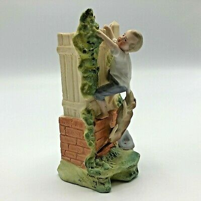 Antique Bisque Figurine Boy Climbing Wall w Dog in Pursuit Hand Painted Germany