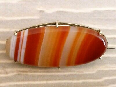 An Antique Small Oval Victorian Brooch Set With A Striped Agate Stone