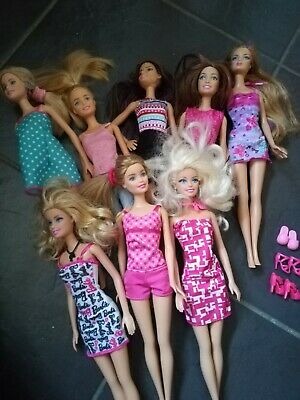 8 various barbie dolls with dresses