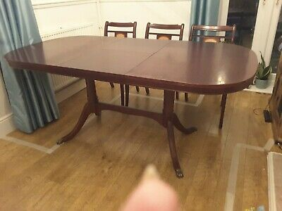 MCINTOSH VINTAGE MAHOGANY EXTENDING DINING TABLE AND CHAIRS & a wall unit.