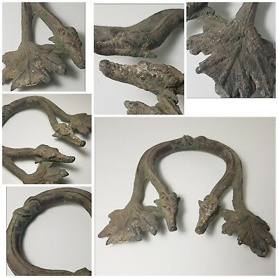 Ancient greek bronze handle with two dragon head