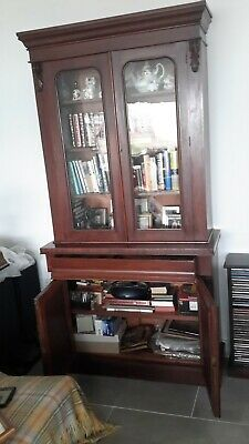 Antique mahogany bookcase with drawer and cupboard.