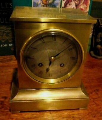 Antique Bronze Cased French 8 Day Movement Striking Mantelclock with Silvered Fa