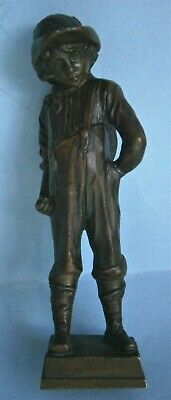 Antique Bronze Figurine Depicting Boy with Back Pack from the early 1900's