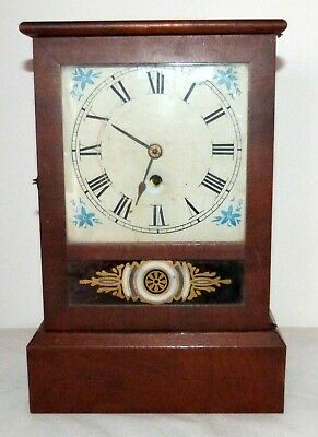 Antique Jerome American mantle clock in good working condition with original key