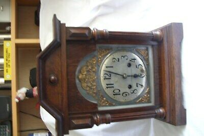 Antique Edwardian Oak Striking Bracket Clock With Gilt Metal Spandrels.