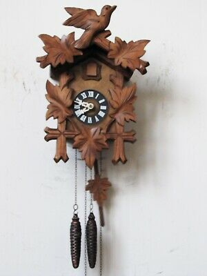 "Black Forest Cuckoo Clock. 13.5"" in High. Good Working Order."