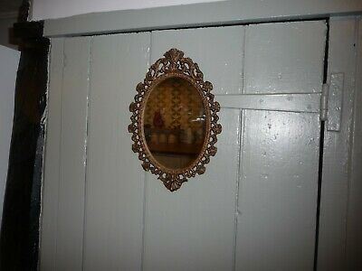 Vintage ornate oval mirror by Castcraft , London.21cm tall oval mirror.