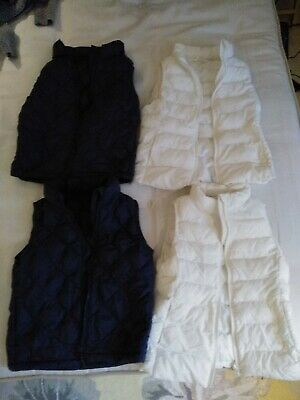 Joblot 4x Uniqlo puffer gilets age 7-8. Two navy blue two white