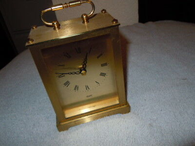 Quartz carriage clock, gold face roman numerals, battery operated, Germany made