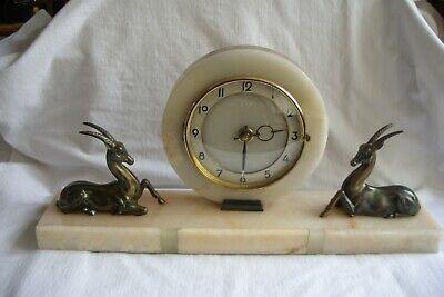 French Art Deco Marble Clock On A Plinth With Two Reclining Antelope.