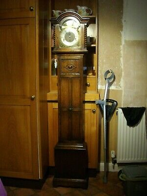 Super little oak Grandmother clock with Westminster Chimes. Brass dial. W/Order.