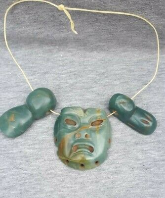 Pre-Columbian Olmec Blue Jade mask and duck pendants from Mexico. Ca.