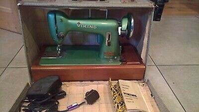 Vintage Viking Husqvarna green class 18 electric sewing machine.