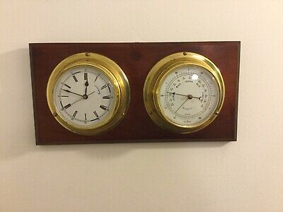 Brass Weather-Master Barometer And Quartz Clock Mounted On Wood