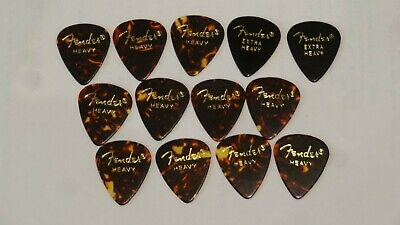 11 Fender heavy, 2 extra heavy tortoise shell guitar picks