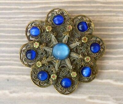An Art Deco Czech Round Filigree Brooch Set With Blue Cabochon Cut Stones