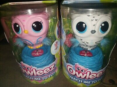 2 white and pink Owleez, Flying Baby Owl Interactive Toy with Lights and Sounds