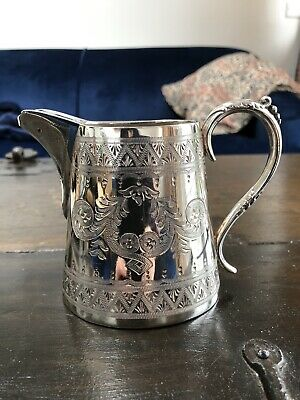 Silver plated antique jug very pretty engraving