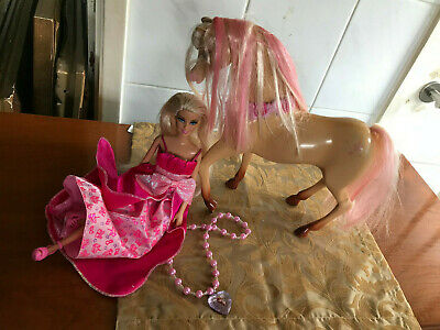 Barbie doll with horse with brown feet bottom, blonde& pink hair, frozen pendant