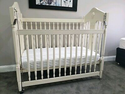 Baby's Cot. Collapsable sides. Cream