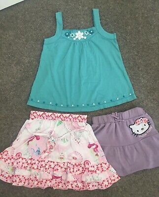 LG21 4-5 years outfits. green flowers Monsoon top Hello Kitty & Oilily skirt