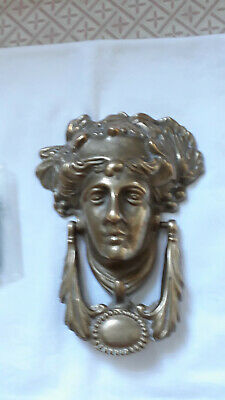 Unusual large solid brass door knocker, face of ancient Roman, with fixings